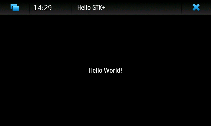 Screenshot of test application showing 'Hello World!' in the centre of a themed window